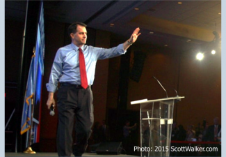 Scott Walker on stage at campaign waving goodbye as he ends his campaign.