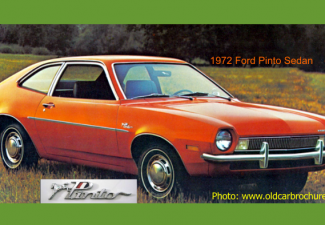 1972 Ford Pinto, orange colored, pictured in a field of yellow and orange flowers.