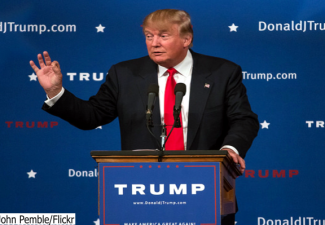 2016 Republican presidential candidate speaking from a podium during a campaign stop